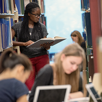 400x400px square image of students in the library